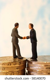 Two Business People Shaking Hands a Deal
