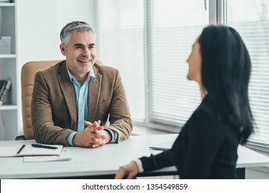 The two business people talking at the office table