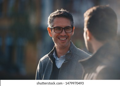 Two  business people walking outdoors