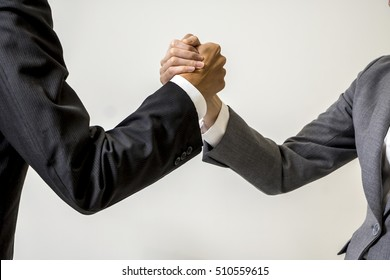 two business persons holds hands