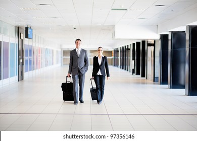 two business travellers walking in airport
