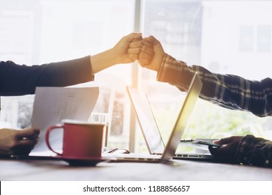 Two business use hand to fist bump for succes teamwork coporate,Office Team Meeting with Hands together. Industry Business Work Concept