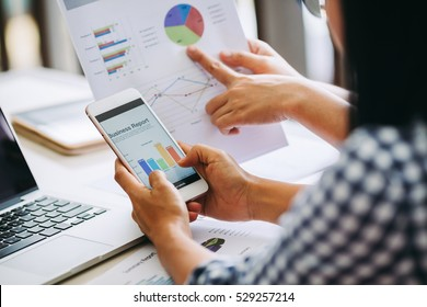 Two business woman investment consultant analyzing company annual financial report balance sheet statement working with documents graphs. Concept picture of business, market, office, tax.