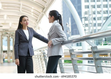 Two business woman talking at site outdoors in the city. concept of meeting, consult and interview.