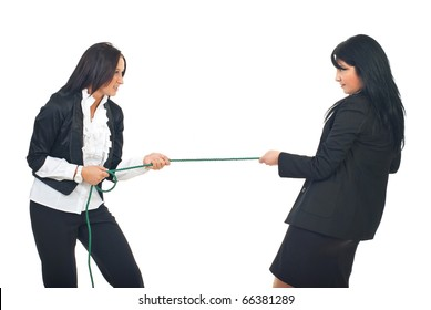 Two business women in competition pulling rope isolated on white background