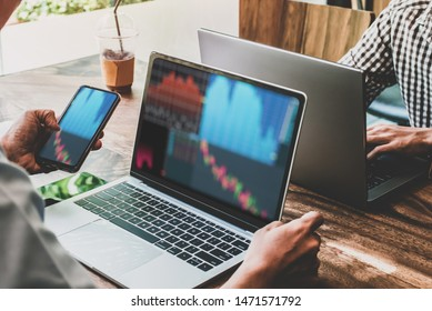 Two Businessman holding smartphone pointing and look directions change Average line Share price movement Stock trading in the up and down on display