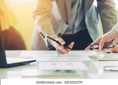 Two businessman investment consultant analyzing company financial report balance sheet statement working with documents graphs. Concept picture for stock market, office, tax, and project.