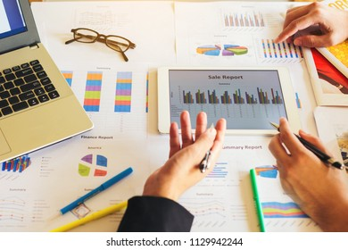 Two businessman investment consultant analyzing company financial report balance sheet statement working with documents graphs. Concept picture for stock market, office, tax,and project.