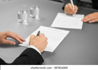 Two businessman make a deal. A corporate agreement. Giving guarantees. Everything is official.