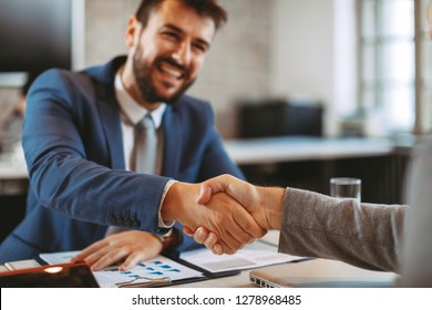 Two businessman make a deal and shake hands