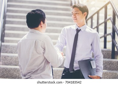 two businessman meeting and greet at modern office. hand shake