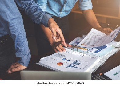 two businessman planning strategy on desk with paperwork, Strategist team analyze data or information.