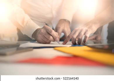 Two businessman reviewing and signing a contract