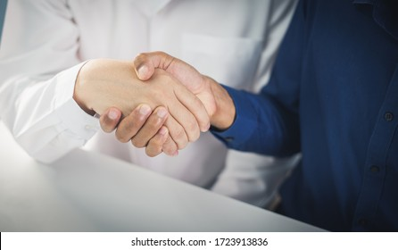two businessman shake hand after complete success project with teamwork.