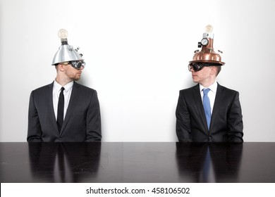 Two businessman sitting at office desk