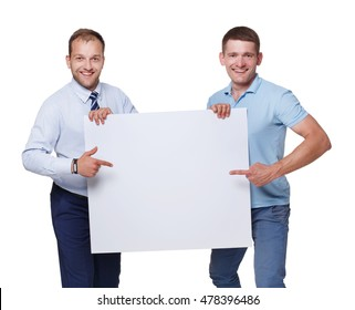 Two businessmen carry and show blank advertising board, isolated on white background. Big white poster in man's hands with copyspace.