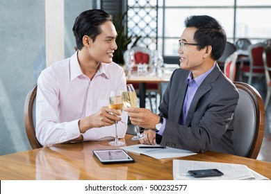 Two Businessmen Celebrating Success with Champagne