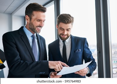 Two businessmen discussing at office during business meeting