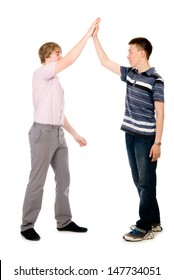 Two businessmen give each other a high five.
