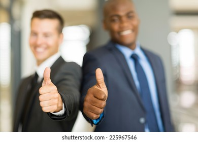 two businessmen giving thumbs up