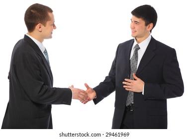 Two businessmen greet
