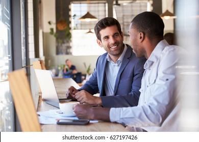 Two Businessmen Having Informal Meeting In Coffee Shop