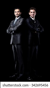 two businessmen isolated over black background