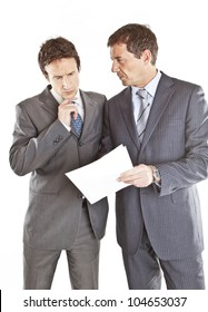 Two businessmen looking at documents