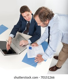 Two businessmen looking at a laptop