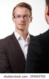 two businessmen at a meeting close-up portrait