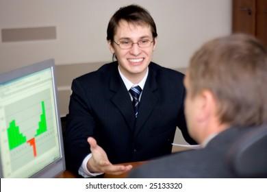 two businessmen in office talking