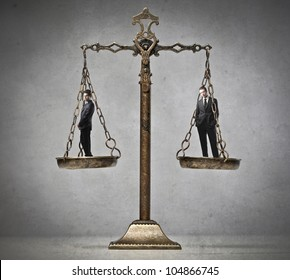 Two businessmen on a balance