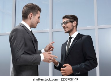 two businessmen posing