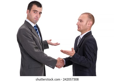 Two businessmen rejecting the responsibility and absolving themselves of guilt with a handshake, isolated on white