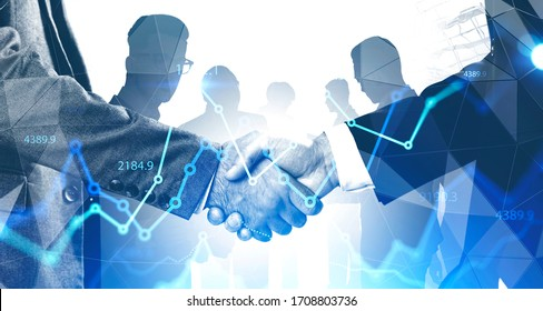 Two businessmen shaking hands in abstract city with double exposure of blurry diverse business people and financial graphs. Concept of partnership and stock market. Toned image