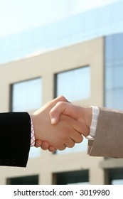 Two businessmen shaking hands after agreement about a job