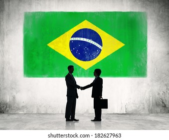 Two Businessmen Shaking Hands With Flag of Brazil