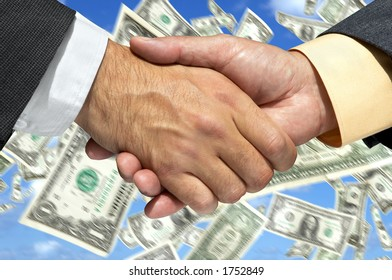 Two businessmen shaking hands on the money background