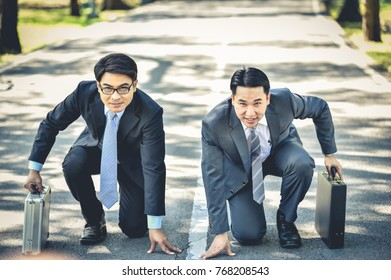 Two businessmen are showing off their runners.Business Competition Concepts.