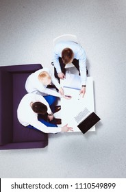 Two businessmen sitting at their desk with laptop. Top view