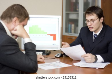 two businessmen solving problems indoors