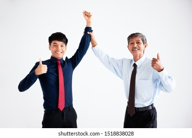 Two businessmen are standing with smiling and thumbs them up after their business success deals. Photo on white background. isolated.