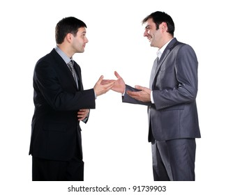 Two businessmen standing and talking and one of them smiling