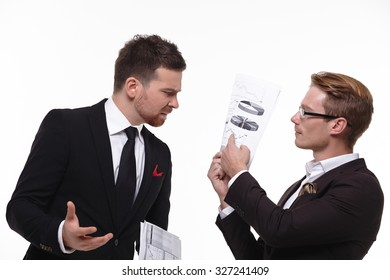 two businessmen studying the paper at the meeting
