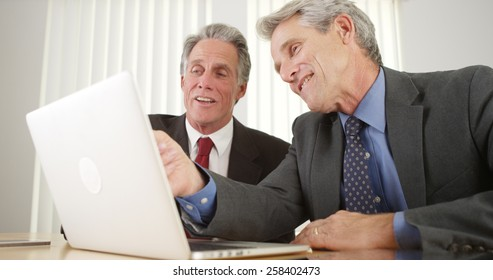 Two businessmen working on laptop in the office