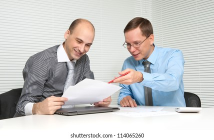 two businesspeople having a discussion in office