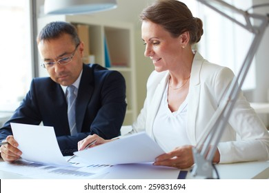 Two businesspeople sharing information