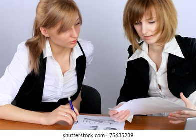 Two businesswoman having a meeting in office