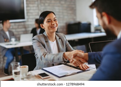 Two businesswoman make a deal and shakehands