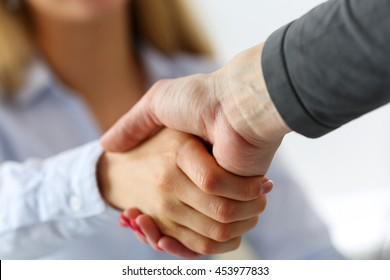 Two businesswoman shake hands as hello in office closeup. Friend welcome, introduction, greet or thanks gesture, product advertisement, partnership approval, arm, strike a bargain on deal concept